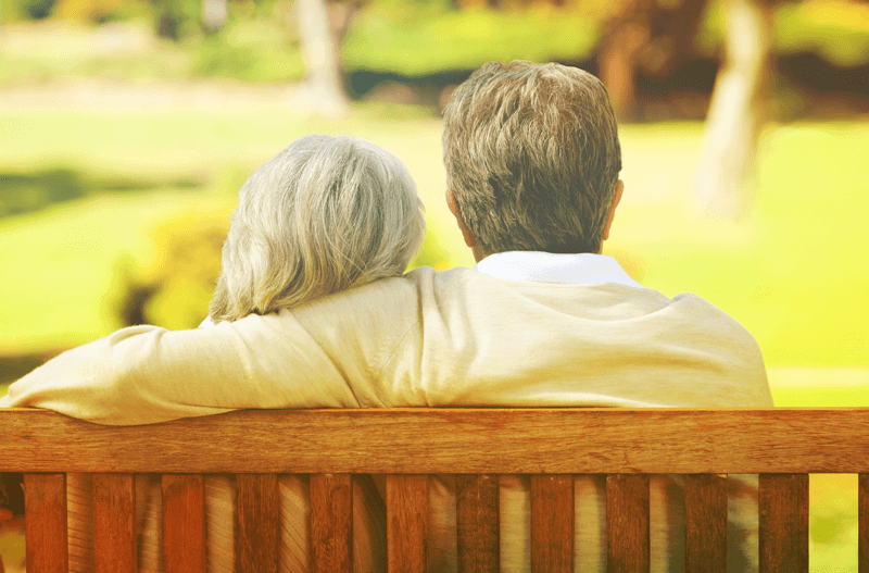 Retired Couple sitting on bench